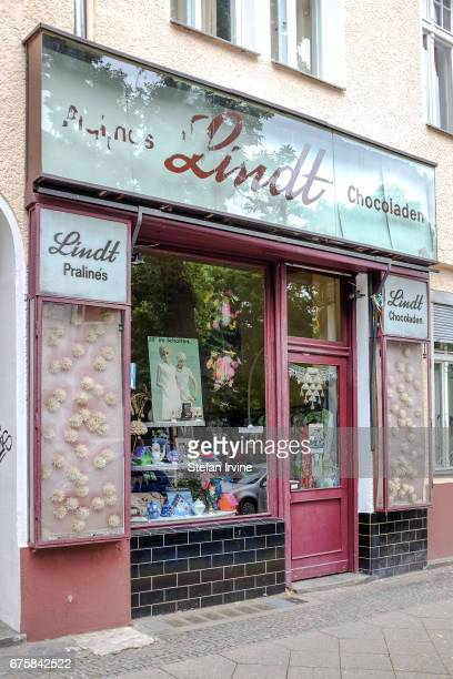 Vintage signage for the Swiss chocolatier Lindt has not been removed from the exterior of a shop which now sells clothes and various knickknacks