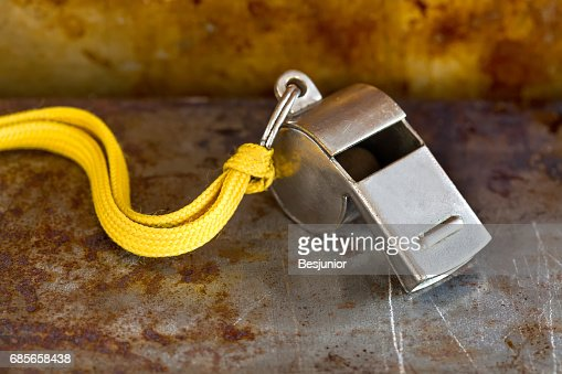 Vintage silver whistle on rusty metallic background. Referee trainer sport competition tool instrument, start finish stopping game and attention moments equipment. Close-up photo : Stock Photo