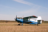 Vintage single-engine biplane aircraft ready to take off
