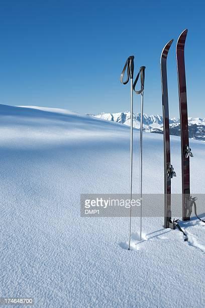 Vintage Ski's and ski poles stood in fresh new snow