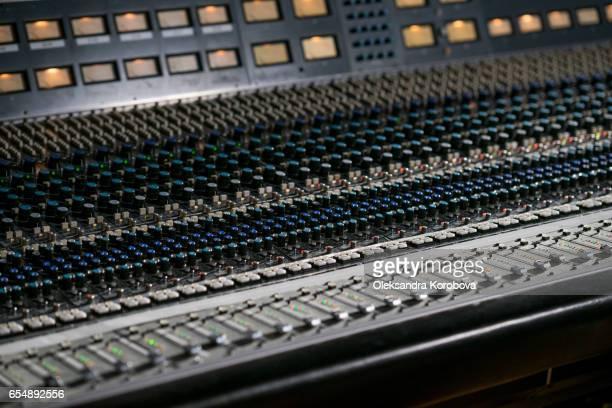 Vintage sound or audio mixer in a recording studio.