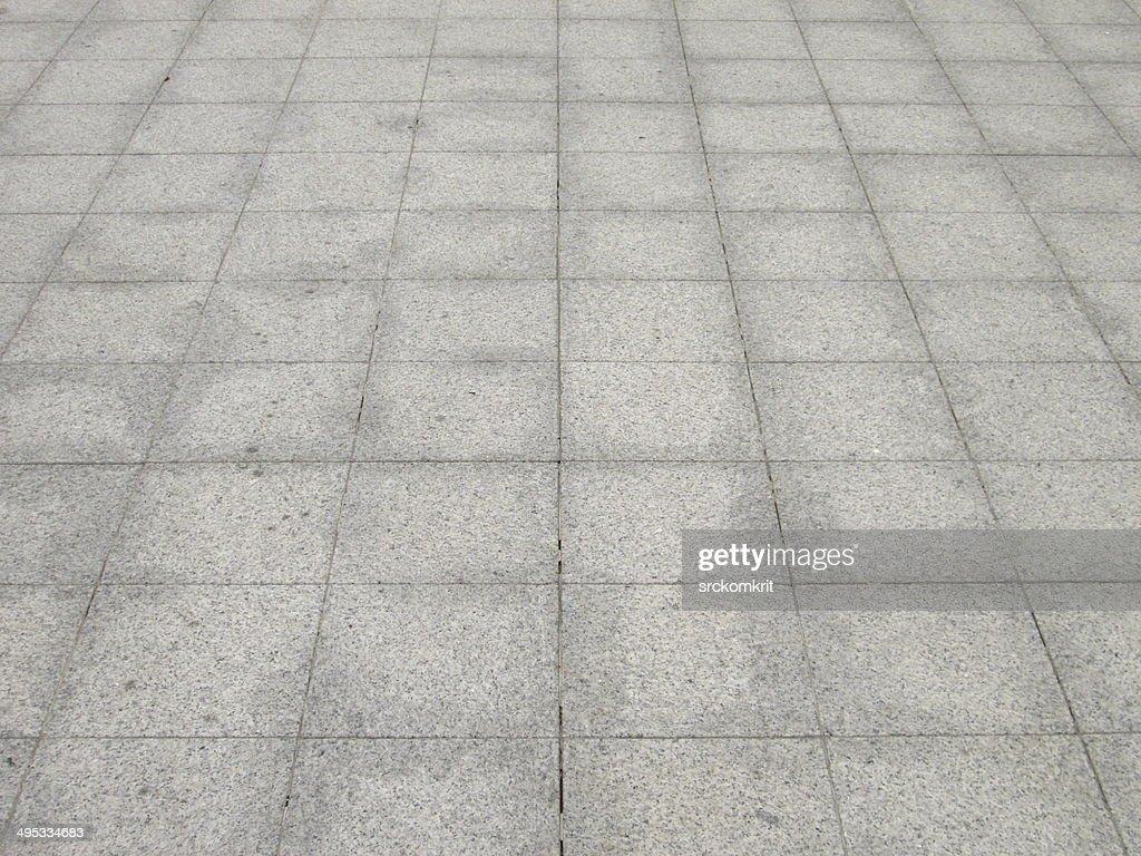 Vintage strada di pietra pavimentazione stradale di tessuto foto