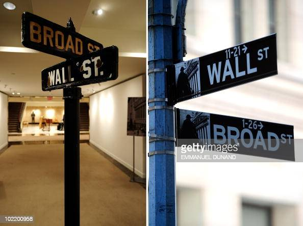 A vintage street sign that stood at the intersection of Manhattan's Wall Street and Broad Street is on display at Christie's and the modernday street...