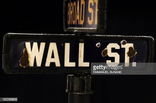 A vintage street sign that stood at the intersection of Manhattan's Wall Street and Broad Street is on display at Christie's in New York June 18 2010...