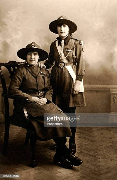 A vintage studio portrait of two young Girl Guides circa 1930