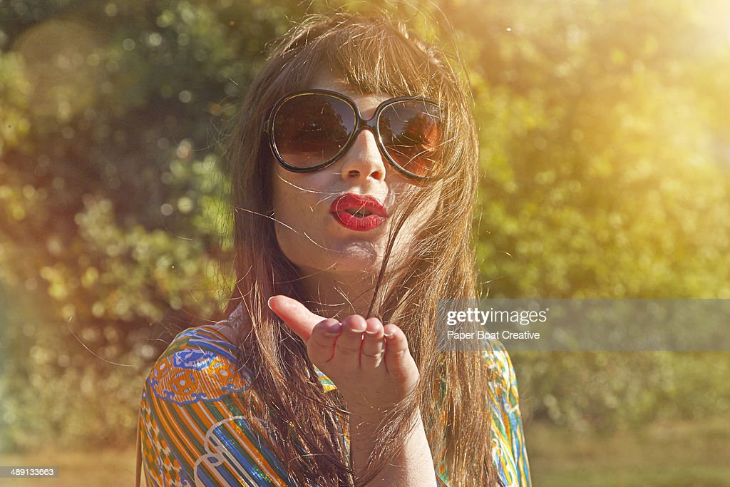 Vintage Style Photo of a lady blowing a kiss