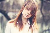 Vintage Style Portrait of Young Beautiful Girl with Windy Hair