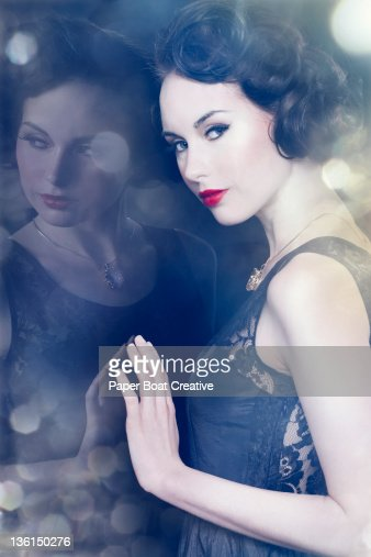 vintage styled lady leaning against a mirror