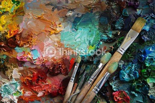 Vintage stylized photo of paintbrushes closeup and artist palett : Stock Photo