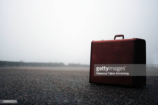 Vintage suitcase in morning fog.