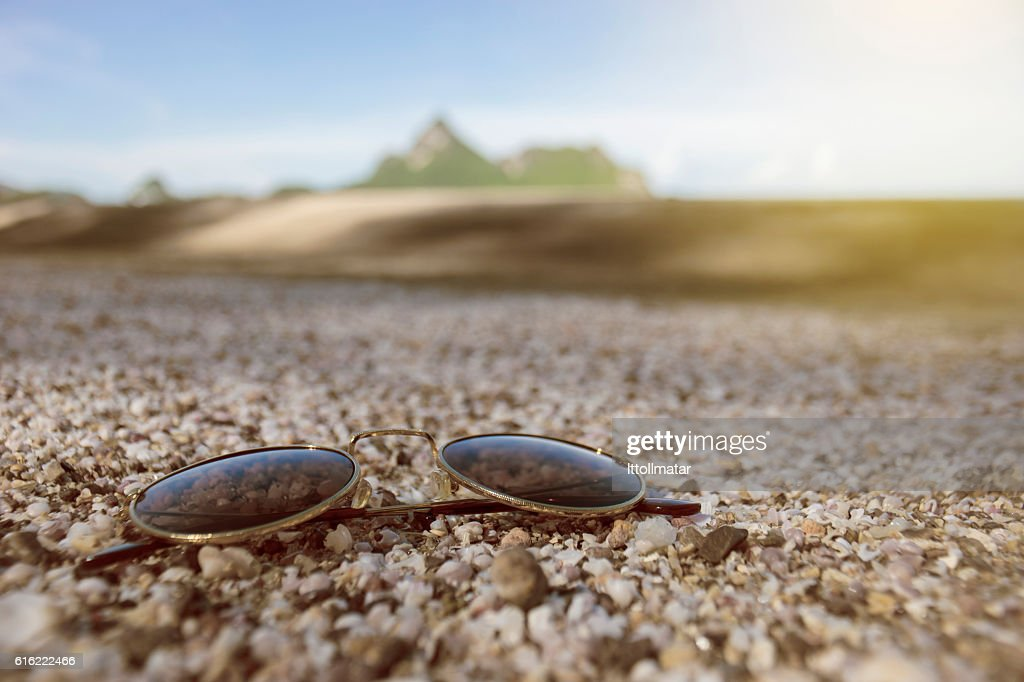 vintage sunglasses put on a lot of broken small corals : Stock Photo