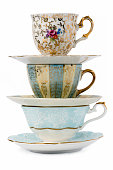 Decorated antique porcelain tea cups with  saucers.