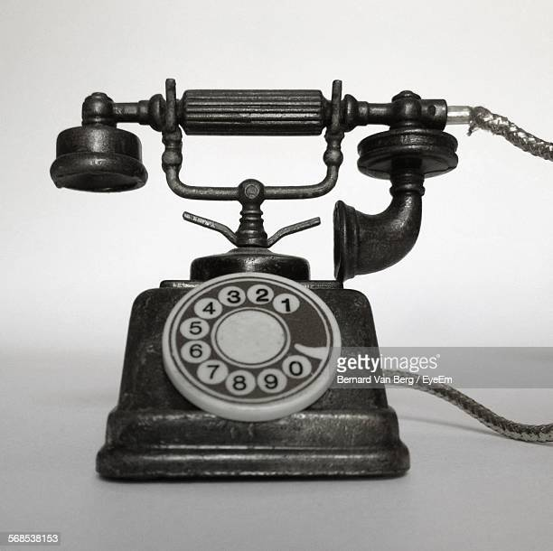 Vintage Telephone On Table Against Wall