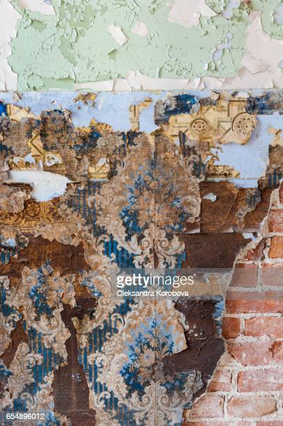 Vintage textures: old wallpaper, peeling paint, brick wall