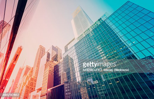 Vintage toned Manhattan skyscrapers at sunset, NYC, USA : Stock Photo