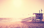 Vintage toned picture of lifeguard tower at sunset, Malibu, USA.