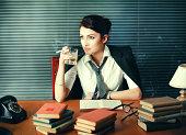 'Vintage toned woman writer drinking and smoking, seeking inspira'