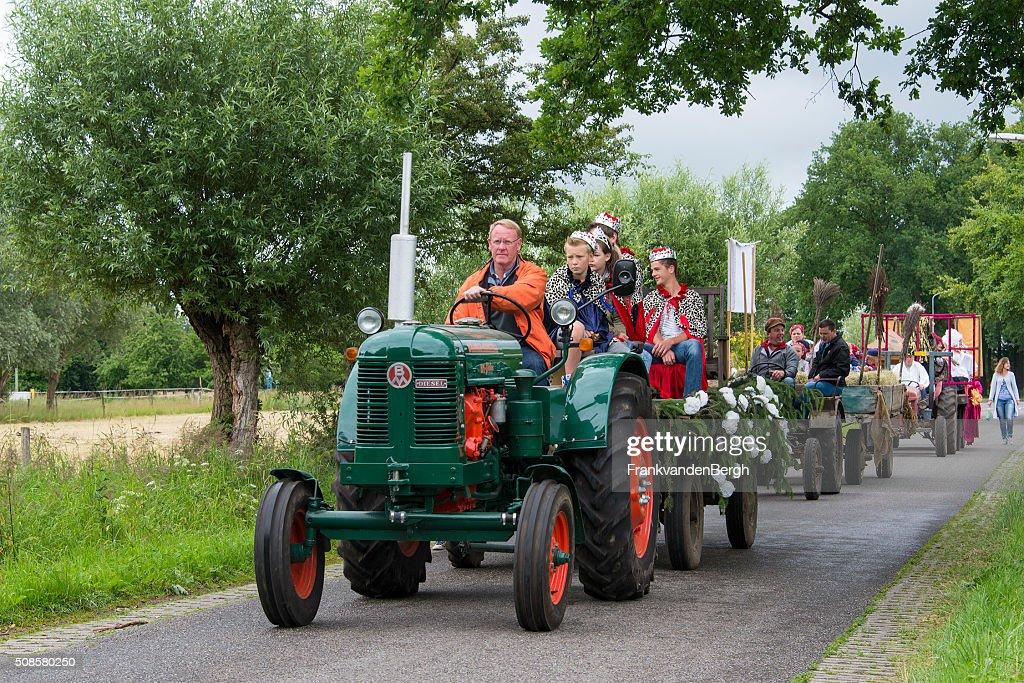 Vintage tractor at carnival parade : Stock Photo