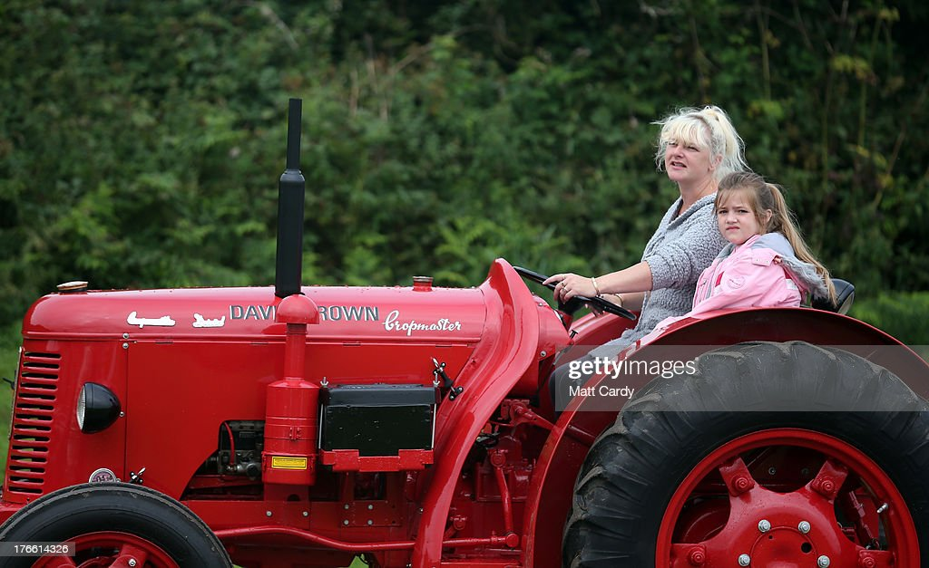 A vintage tractor is driven into the showground at the Cornish Steam and Country Fair at the Stithians Showground on August 16, 2013 near Penryn, England. The annual show, now in 58th year, is one of Cornwall's largest outdoor events and is one of the UK's most popular and respected steam rallies.