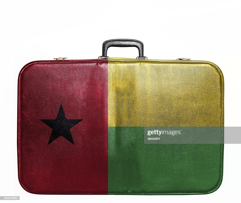 Vintage travel bag with flag of Guinea Bissau : Stock Photo