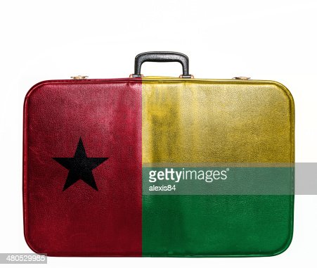 Vintage travel bag with flag of Guinea Bissau : Bildbanksbilder