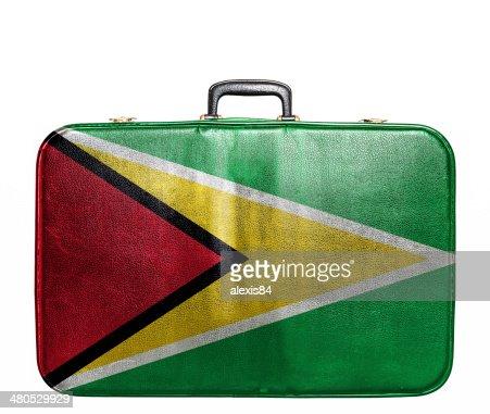 Vintage travel bag with flag of Guyana : Bildbanksbilder