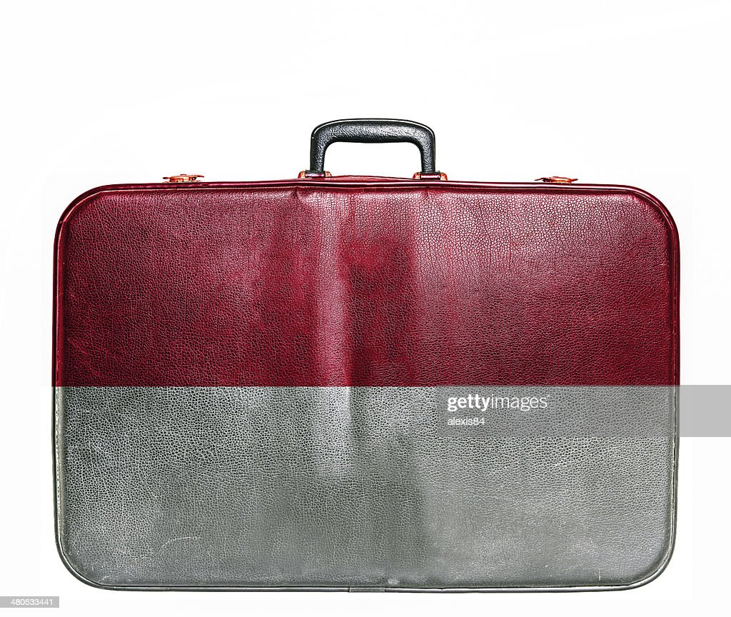Vintage travel bag with flag of Monaco : Stock Photo