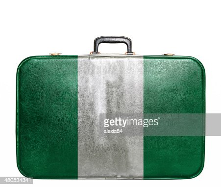 Vintage travel bag with flag of Nigeria : Stock Photo