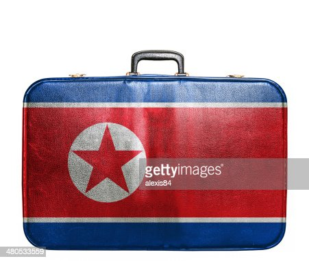 Vintage travel bag with flag of North Korea : Stock Photo