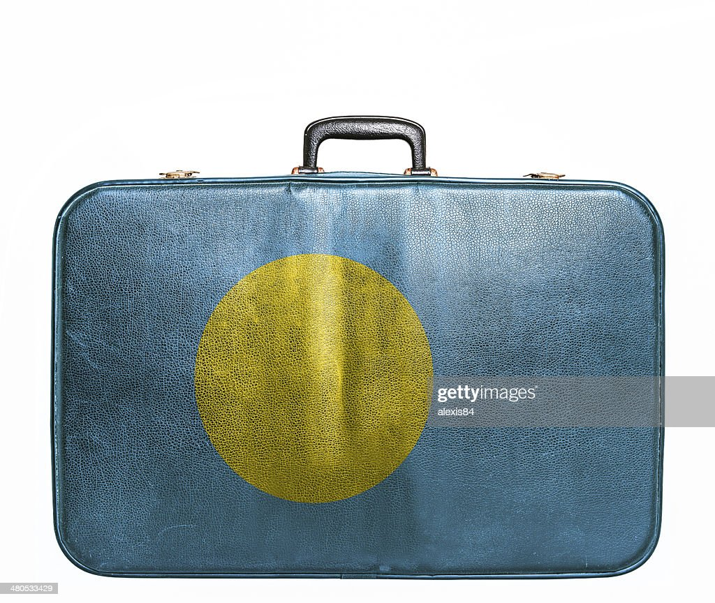 Vintage travel bag with flag of Palau : Stock Photo