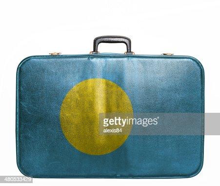 Vintage travel bag with flag of Palau : Stock Photo