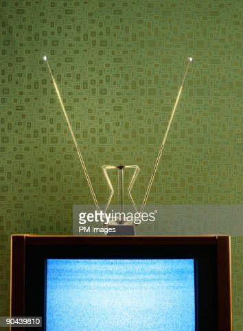 Vintage TV, antenna, and wallpaper : Stock Photo