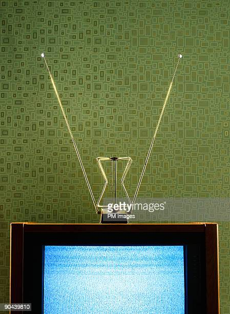Vintage TV, antenna, and wallpaper