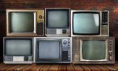 Vintage tv on wood shelf background