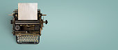 Vintage typewriter header with old paper. retro machine technology - top view and creative flat lay design.