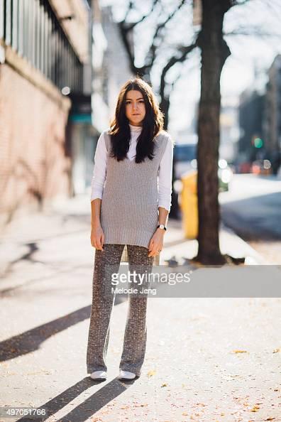 A Vintage Vice blogger and stylist Emma sousa wears a gray Design History sweater vest white Vince turtleneck gray knit widelegged pants white Matt...