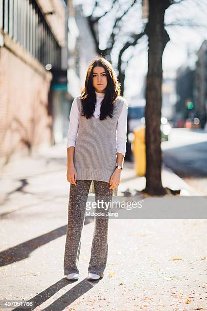 A Vintage Vice blogger and stylist Emma sousa wears a gray Design History sweater vest white Vince turtleneck gray knit widelegged pants white Matt...