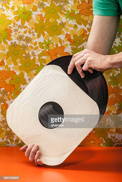 Vintage Vinyl Record Being Removed from Paper Cover