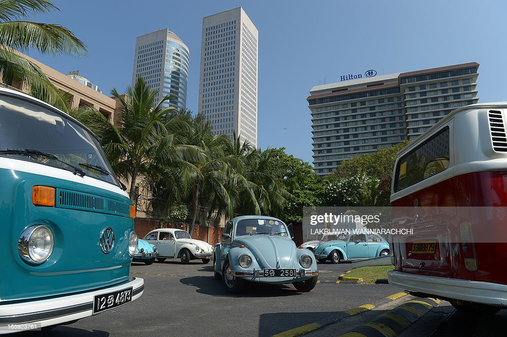 A vintage Volkswagen Beetle car and van are displayed during Volkswagen owner's club ' pride of ownership' diamond jubilee rally 2013 in Colombo on April 7, 2013. Volkswagen owners hold an annual pageant in Sri Lanka to show off their vintage cars.