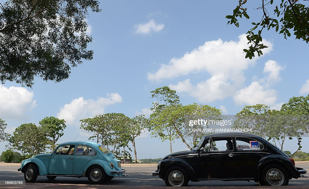 Vintage Volkswagen Beetle car's are displayed during a Volkswagen owner's club ' pride of ownership' diamond jubilee rally 2013 in Padukka on April 7, 2013. Volkswagen owners hold an annual pageant in Sri Lanka to show off their vintage cars.