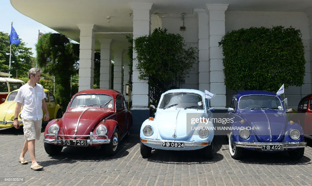 Vintage Volkswagen Beetle cars are parked at a hotel in Colombo on June 26, 2016, during an event to mark Volkswagen Day. Volkswagen owners hold an annual pageant in Sri Lanka to show off their vintage cars. World Volkswagen Day is marked annually on June 22. / AFP / LAKRUWAN