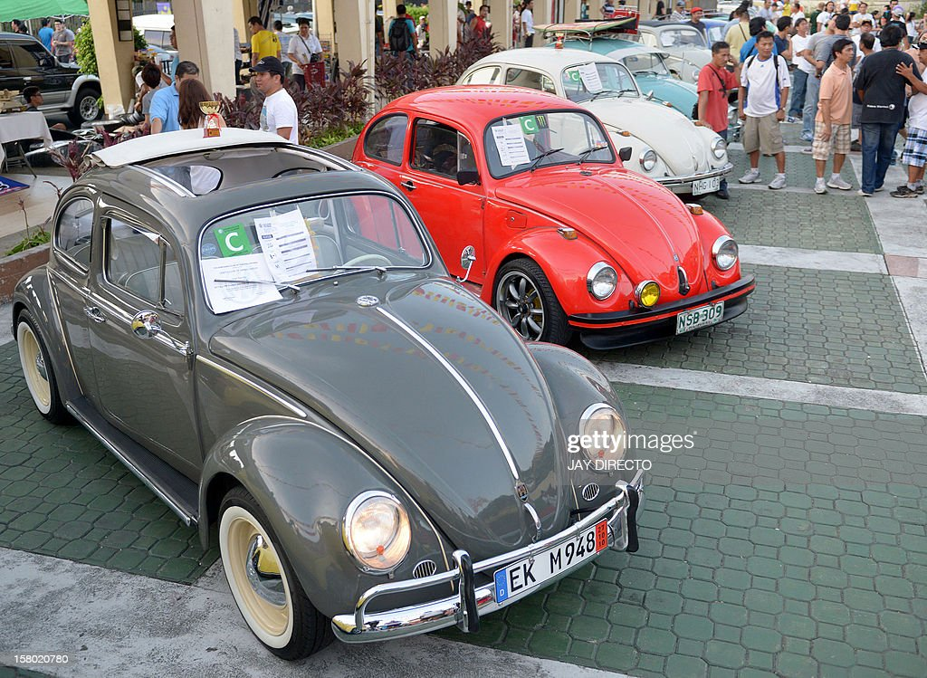 Vintage Volkswagen Beetle cars are parked for an all Volkswagen car show in suburban Manila on December 9, 2012. Clubs all over the country gather every December for the event, with more than 200 Volkswagens on display. AFP PHOTO / JAY DIRECTO
