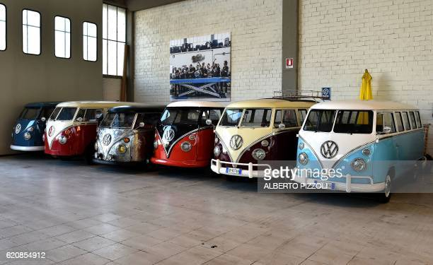Vintage Volkswagen Kombi bus are parked in a garage after being completly restored by mechanics of the 'T1 specialist' company on November 3 2016 in...