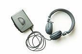 Vintage walkman and headphones isolated on white background.