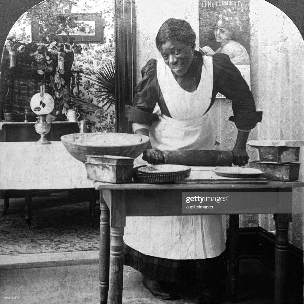 Vintage woman rolling bread dough