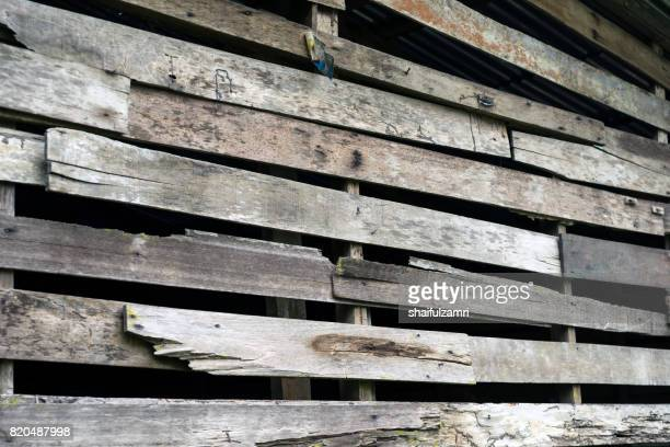 Vintage wooden background - old house with degraded structure