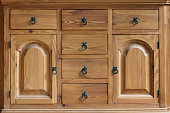 Vintage wooden cabinet with drawers and doors close up
