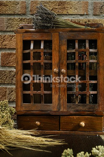 Vintage Wooden Spice Rack Or Storage Cabinet Stock Photo Thinkstock