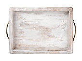 Vintage wooden tray with bronze handles isolated on white background