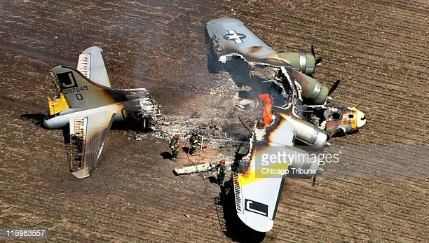 A vintage World War II bomber crashed and burned in a field southwest of Aurora Illinois but the seven people on board survived according to aviation...